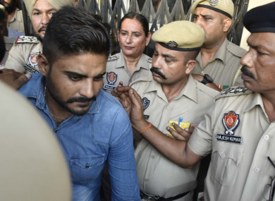 Deepak Khajuria, convicted in the Kathua rape and murder case, leaves the District Court