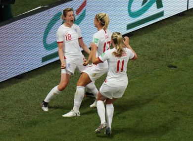 England's Ellen White celebrates scoring her side's first goal.