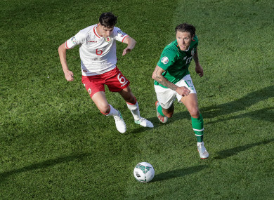 Ireland's Jeff Hendrick and Louie Annesley of Gibraltar.