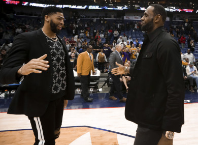 New Orleans Pelicans forward Anthony Davis meets with Los Angeles Lakers forward LeBron James.