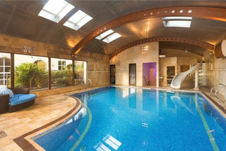 4 Of A Kind Make A Splash In These Luxury Homes With Their Own Pools