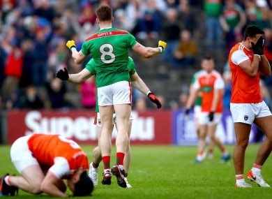 Paddy Durcan and Donie Vaughan celebrate at full-time.