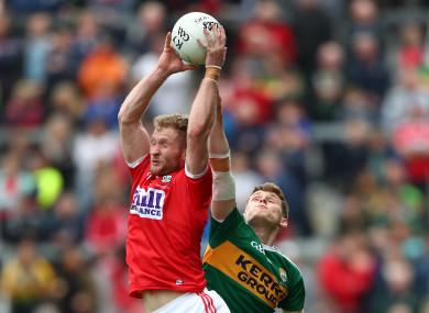 Cork's Ruairi Deane and Kerry's Gavin White in action.