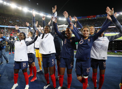 French players celebrate their emphatic victory.