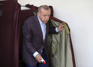 Turkey's President Recep Tayyip Erdogan casts his ballot at a polling station in Istanbul