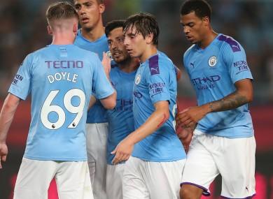 The Man City players celebrate with goalscorer David Silva.