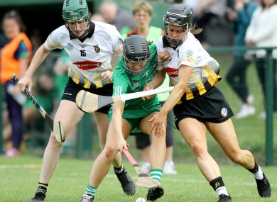 Denise Gaule and Katie Power tackle Mairead Ryan.