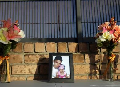 A framed photo of Óscar Alberto Martínez Ramírez and his daughter Angie Valeria sits on an altar near their home