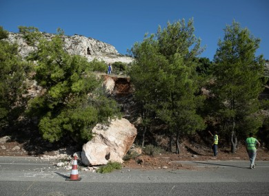 Fallen rocks block part of a road following an earthquake in Athens, Greece, on July 19.