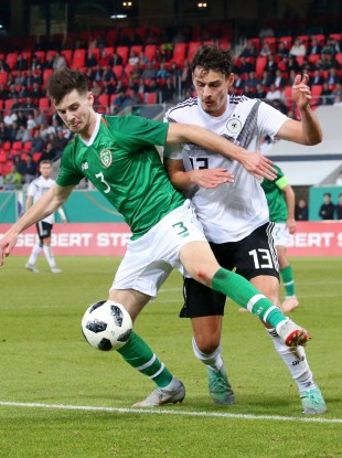 Danny Kane tussling with Germany's Jani Serra during last October's Euro U21 qualifier.