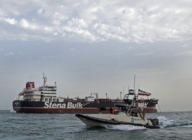 Iran's Revolutionary Guard circles a British-flagged speedboat.