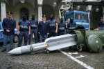 Anti-terrorist police with an air-to-air missile seized during an operation in Turin