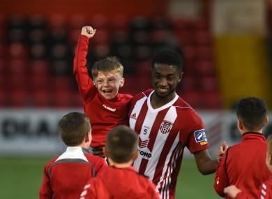 Derry City's Junior Ogedi Uzokwe celebrates with fans after the game.
