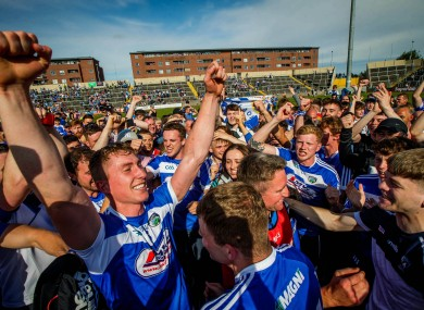 Laois players celebrate after their victory over Dublin.
