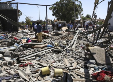 Debris covers the ground after an airstrike at the detention center in Tajoura, east of Tripoli in Libya