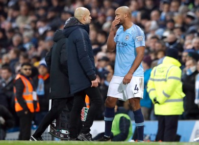 Manchester City manager Pep Guardiola (left) and former club captain, Vincent Kompany.