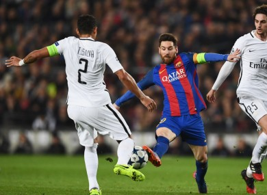 Lionel Messi pictured competing against Thiago Silva.