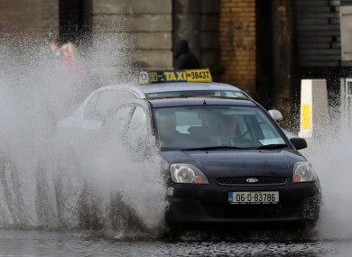 Cars navigate a flooded street in Dublin as the tail end of Storm Diana last year