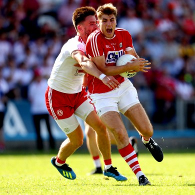 Tyrone's Padraig Hampsey and Cork's Ian Maguire in action when the sides met last year.