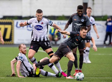 Dundalk's Patrick McEleney and Chris Shields with Joel Bopesu and Ritvars Rugins of Riga FC.