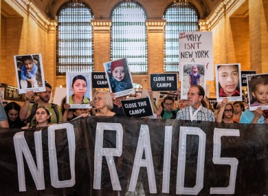Activists protesting against immigration raids on 8 July in New York's Grand Central Station