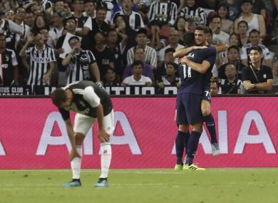 Troy Parrott celebrates with Erik Lamela against Juventus.