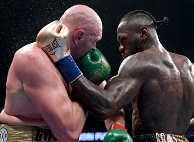 Tyson Fury and Deontay Wilder during their December fight.