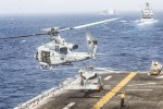 A US helicopter takes off from the assault ship USS Boxer during a transit of the Strait of Hormuz on Thursday.