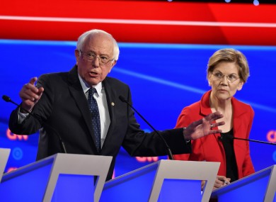 Vermont Sen. Bernie Sanders and Massachusetts Sen. Elizabeth Warren participate in the first day of the CNN Democratic Presidential Debate.