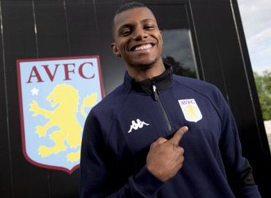 Wesley looking happy to be a Villa player.
