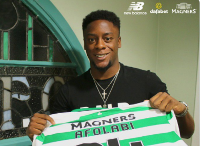 Jonathan Afolabi poses with a Celtic jersey.