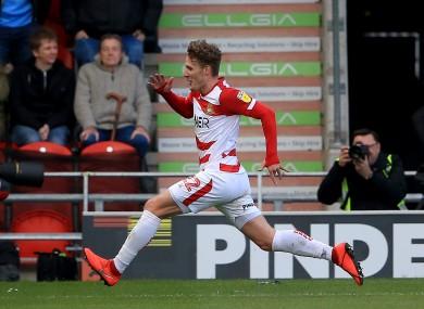Sadlier celebrates scoring for Doncaster Rovers.