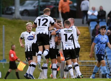 Dundalk players celebrate with goal scorer Daniel Cleary.