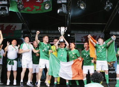 The Irish team celebrate with the Glyndwr Cup.