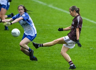 Tracey Leonard of Galway scores a goal past Emma Murray of Waterford.
