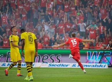 Marius Buelter celebrates his goal amid delirium in Berlin.