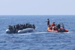 A rescue team of the Ocean Viking ship, operated by the NGOs Sos Mediterranee and Doctors Without Borders, approaches a rubber dinghy with over 80 migrants off the Libyan coast.