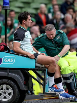 Carbery has his knee assessed after being replaced in the second half.
