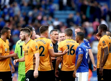 Referee Andre Marriner (centre) speaks to Wolverhampton Wanderers players at the end of the Premier League match.