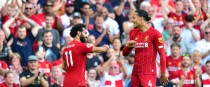 Salah celebrates his second goal with Virgil van Dijk.