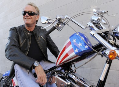 Fonda poses atop a Harley-Davidson, October 2009.