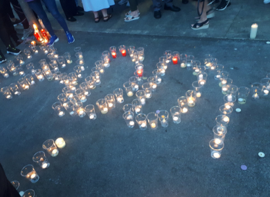 Candles laid by locals during last week's vigil.