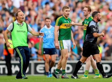 Kerry players Peter Crowley and Colm Cooper with referee David Gough after the 2017 All-Ireland final.