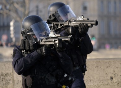 File photo of police officers at a previous yellow vest protest in Paris.
