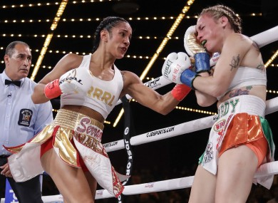 Amanda Serrano (L) throws a left uppercut at Heather Hardy.