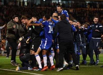 Colchester United fans celebrate after their win over Spurs.