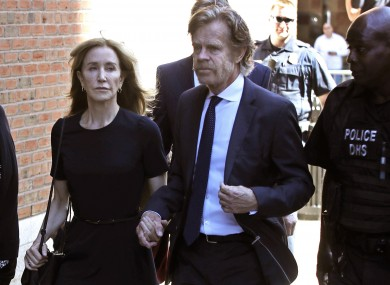 Felicity Huffman arrives at federal court with her husband William H. Macy for sentencing in a nationwide college admissions bribery scandal.