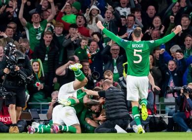 David McGoldrick celebrates scoring a goal against the Swiss.