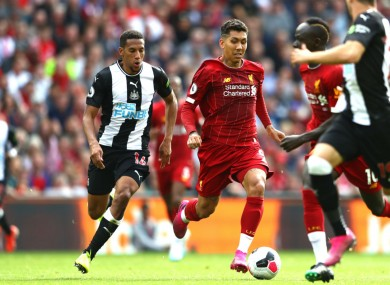 Roberto Firmino in action against Newcastle United
