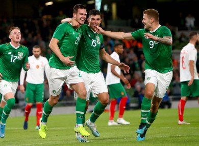 Ireland's Kevin Long celebrates scoring his side's second goal with John Egan and James Collins.
